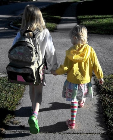 free_two_happy_girls_holding_hands_walking_to_school_at_sunrise_creative_commons-500x619.jpg